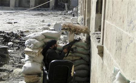A member of the Free Syrian Army takes a position as he points his weapon in a mosque in Aleppo, March 10, 2013. Picture taken March 10, 2013. REUTERS/Mahmoud Hassano