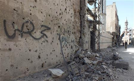 The word 'Homs' reads on a wall riddled with holes, in the besieged area of Homs, March 9, 2013. REUTERS/Yazan Homsy