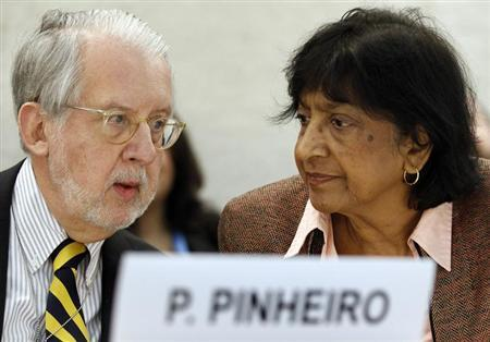 Chair of the Commission of Inquiry on Syria Paulo Pinheiro (L) talks with U.N. human rights chief Navi Pillay before the Human Rights Council at the United Nations in Geneva March 11, 2013. REUTERS/Denis Balibouse