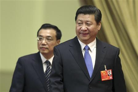 Xi Jinping (front), general secretary of the Central Committee of the Communist Party of China (CPC), and Li Keqiang, a member of the Standing Committee of the Political Bureau of the CPC Central Committee and Vice Premier, arrive at the third plenary meeting of the first session of the 12th National People's Congress (NPC) held at the Great Hall of the People in Beijing March 10, 2013. REUTERS/China Daily