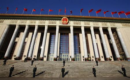 Security officers stand guard outside the Great Hall of the People during the third plenary session of the National People's Congress (NPC) in Beijing March 10, 2013. REUTERS/Petar Kujundzic