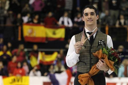 Gold medallist Javier Fernandez of Spain poses during the award ceremony for the men's skating at the European Figure Skating Championships in Zagreb January 26, 2013. REUTERS/Antonio Bronic