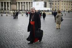 Cardinal Thomas Collins of Canada walks through Saint Peter's Square as he arrives for a meeting in the Synod Hall at the Vatican March 11, 2013. REUTERS/Dylan Martinez