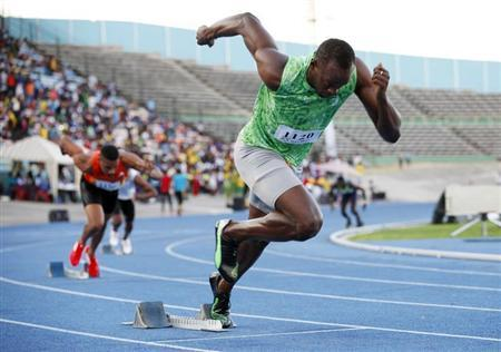 Jamaican runner Usain Bolt starts in the men's 400m race of the Camperdown Classic, an annual track event in its ninth year, in Kingston February 9, 2013. REUTERS/Gilbert Bellamy