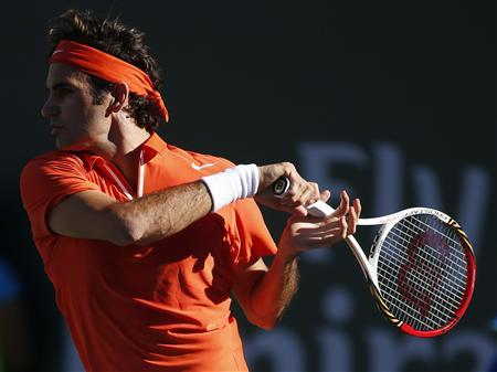 Roger Federer of Switzerland returns a shot against Ivan Dodig of Croatia during their match at the BNP Paribas Open ATP tennis tournament in Indian Wells, California, March 11, 2013. REUTERS/Danny Moloshok