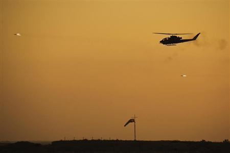 An Israeli Cobra helicopter fires missiles at targets during the air force pilots' graduation ceremony at Hatzerim air base June 30, 2011. REUTERS/Amir Cohen