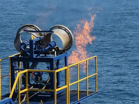 Burned gas separated from methane hydrate gas is seen on the deep-sea drilling vessel ''Chikyu'' in the Pacific, off Aichi Prefecture, central Japan, in this handout photo taken and released by Japan Oil, Gas and Metals National Corporation (JOGMEC) March 12, 2013. REUTERS/JOGMEC/Handout