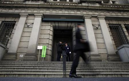 A man walks past the Bank of Japan in Tokyo March 7, 2013. REUTERS/Yuya Shino