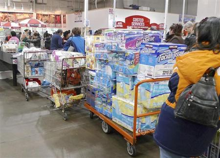 Shoppers wait to pay in Costco in Fairfax, Virginia, January 7, 2010. REUTERS/Larry Downing