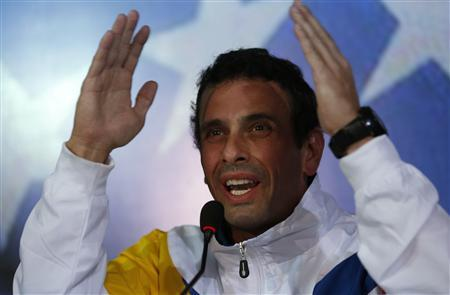 Venezuela's opposition leader and presidential candidate Henrique Capriles gestures during a news conference in Caracas March 11, 2013. REUTERS/Tomas Bravo