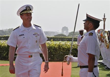 U.S. Chief of Naval Operations (CNO) Admiral Jonathan Greenert (L) inspects a guard of honour during his ceremonial reception in New Delhi April 23, 2012. REUTERS/B Mathur