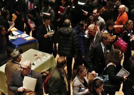 People wait in line to meet a job recruiter at the UJA-Federation Connect to Care job fair in New York March 6, 2013. REUTERS/Shannon Stapleton
