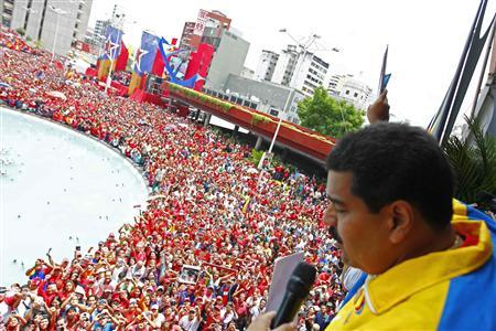 Venezuela's acting President, Nicolas Maduro, gestures to supporters after he registered as a candidate for president in the April 14th election outside the national election board in Caracas March 11, 2013. REUTERS-Carlos Garcia Rawlins