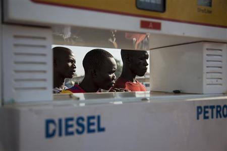 Men wait in line for petrol at a fuel station in Juba October 11, 2012. REUTERS/Adriane Ohanesian