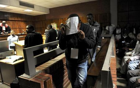 South African police officers arrested on suspicion of murder appear for bail hearing at Benoni court, east of Johannesburg March 11, 2013. REUTERS/Werner Beukes/Pool