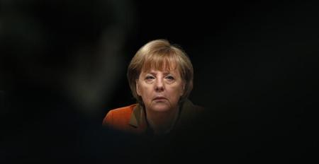 German Chancellor Angela Merkel answers questions from reporters after a meeting with representatives of the German Economic Associations at the International Trade Fair in Munich March 8, 2013. REUTERS/Michaela Rehle
