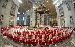 Cardinals attend a mass in St. Peter's Basilica, in a picture released by Osservatore Romano at the Vatican March 12, 2013. REUTERS/Osservatore Romano