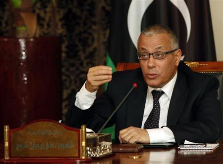 Libyan Prime Minister Ali Zeidan speaks during a joint news conference with other government ministers in Tripoli March 3, 2013. REUTERS/Ismail Zitouny