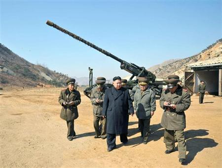 North Korean leader Kim Jong-Un (C) visits a long-range artillery sub-unit of the Korean People's Army Unit 641, whose mission is to strike Baengnyeong Island of South Korea in the western sector of the front line March 11, 2013 in this picture released by the North's official KCNA news agency in Pyongyang March 12, 2013. REUTERS/KCNA