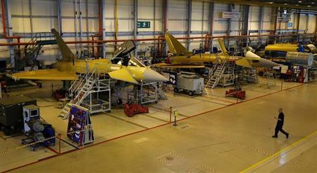 A worker crosses the floor of the Eurofighter Typhoon production line at BAE systems Warton plant near Preston, northern England September 7, 2012. REUTERS/Phil Noble