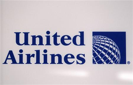 A logo is pictured on a wall during a news conference announcing the merger between Continental Airlines and United Airlines in New York, May 3, 2010. REUTERS/Shannon Stapleton