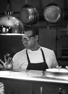 American celebrity chef Tyler Florence cooks in the kitchen of his restaurant Wayfare Tavern in San Francisco, in this undated handout photograph provided by The Door on March 12, 2013. REUTERS/John Lee/The Door/Handout