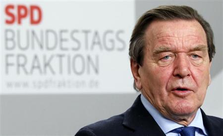 Former German Chancellor Gerhard Schroeder addresses a news conference following a Social Democratic (SPD) parliamentary faction meeting at the Reichstags building in Berlin, March 12, 2013. REUTERS/Fabrizio Bensch