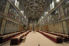 The Sistine Chapel is seen prepared with tables where cardinals will sit when the conclave begins, in a picture released by Osservatore Romano at the Vatican March 12, 2013. REUTERS/ Osservatore Romano