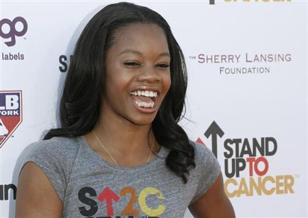 Olympic gold medal gymnast Gabrielle Douglas arrives for the Stand Up To Cancer fundraising telethon at the Shrine Auditorium in Los Angeles, California, September 7, 2012. REUTERS/Jonathan Alcorn