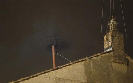 Black smoke rises from the chimney on the roof of the Sistine Chapel in the Vatican City indicating that no decision has been made after the first day of voting for the election of a new pope, March 12, 2013. REUTERS-Dylan Martinez