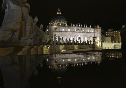 Saint Peter's Basilica is seen reflected from atop the colonnade during the conclave in Saint Peter's Square at the Vatican March 12, 2013. REUTERS-Alessandro Bianchi