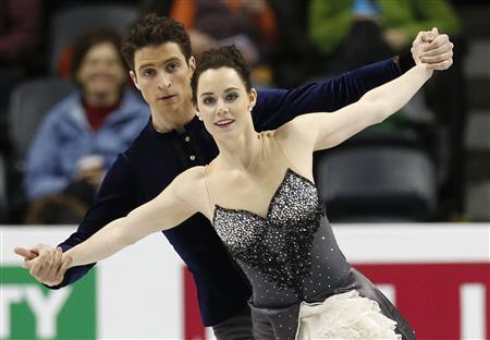 Ice dancers Tessa Virtue (R) and Scott Moir of Canada skate during practice sessions at the ISU World Figure Skating Championships in London, Ontario, March 12, 2013. REUTERS/Mark Blinch