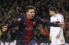 Lionel Messi comemora após marcar gol do Barcelona sobre o Milan nesta terça-feira pela Liga dos Campeões. REUTERS/Albert Gea