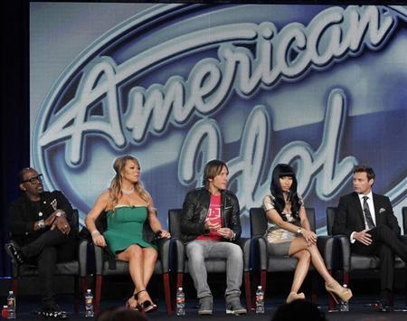 Judges Randy Jackson (L-R), Mariah Carey, Keith Urban, Nicki Minaj and host Ryan Seacrest attend a Fox panel for the television series ''American Idol'' at the 2013 Winter Press Tour for the Television Critics Association in Pasadena, California January 8, 2013. REUTERS/Mario Anzuoni/Files