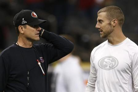 San Francisco 49ers head coach Jim Harbaugh (L) talks with quarterback Alex Smith during warm ups ahead of the NFL Super Bowl XLVII football game against the Baltimore Ravens in New Orleans, Louisiana, February 3, 2013. REUTERS/Mike Segar