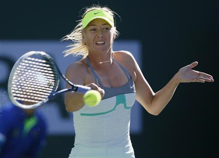 Maria Sharapova of Russia returns a shot against Carla Suarez Navarro of Spain during their match at the BNP Paribas Open WTA tennis tournament in Indian Wells, California, March 10, 2013. REUTERS/Danny Moloshok