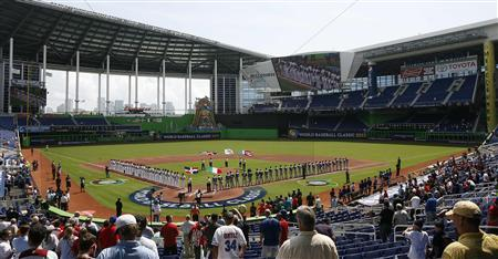 Players from Dominican Republic (L) and Italy (R) line up before their 2013 World Baseball Classic game at Marlins Stadium in Miami, Florida March 12, 2013. REUTERS/Andrew Innerarity