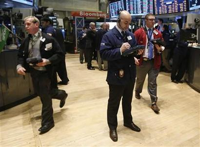 Traders work on the floor at the New York Stock Exchange, March 12, 2013. REUTERS/Brendan McDermid