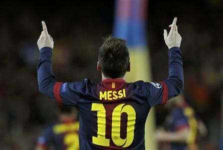 Barcelona's Lionel Messi celebrates after scoring his second goal against AC Milan during their Champions League round of 16 second leg soccer match at Camp Nou stadium in Barcelona March 12, 2013. REUTERS/Albert Gea