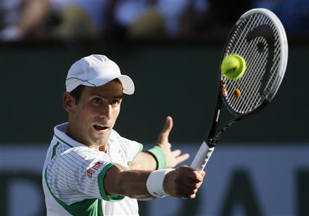 Novak Djokovic of Serbia returns a shot against Grigor Dimitrov of Bulgaria during their men's singles match at the BNP Paribas Open ATP tennis tournament in Indian Wells, California, March 12, 2013. REUTERS/Danny Moloshok