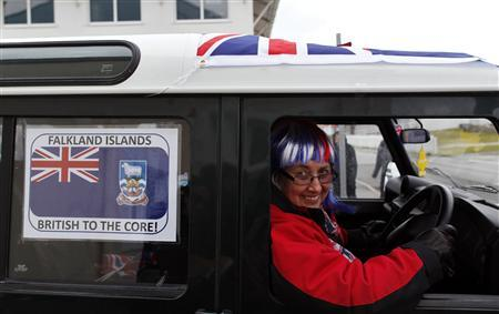 Falklands islander June Besley-Clarck wears a wig with the Union Jack colours as she arrives to the Town Hall polling station in Stanley, March 11, 2013. REUTERS/Marcos Brindicci