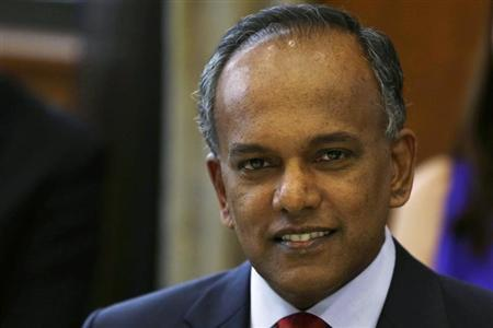 Singapore Foreign Minister K. Shanmugam poses for photos before a dinner with U.S. Secretary of State Hillary Clinton at the Ministry of Foreign Affairs in Singapore November 16, 2012. REUTERS/Matt Rourke/Pool