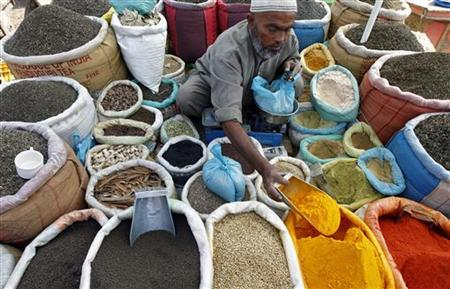 A vendor sells spices on a street in Srinagar September 22, 2011. REUTERS/Fayaz Kabli/Files