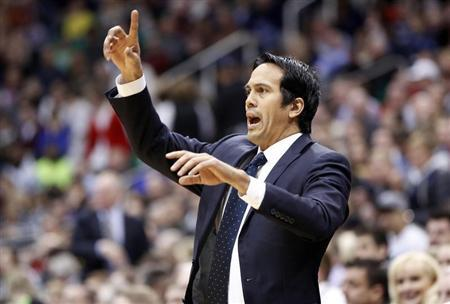 Miami Heat head coach Erik Spoelstra directs his team during the first half of their NBA basketball game against the Utah Jazz in Salt Lake City, Utah January 14, 2013. REUTERS/Jim Urquhart