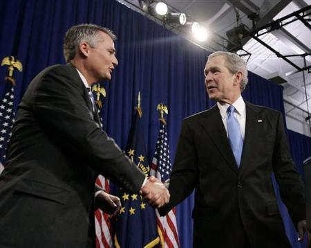 Former President George W. Bush (R) shakes hands with Republican Congressman Chris Chocola (R-IN) in Mishawaka, Indiana February 23, 2006. REUTERS/Jason Reed