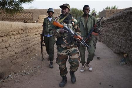 Malian soldiers patrol in the village of Kadji in this March 1, 2013 file photo. REUTERS/Joe Penney/Files