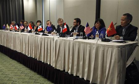 Chief negotiators attend a news conference to conclude the 16th round of the Trans-Pacific Partnership (TPP) negotiations in Singapore March 13, 2013. REUTERS/Edgar Su