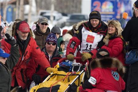 Former Iditarod winner Mitch Seavey is hugged by his wife, Janine, before he takes part in the official restart of the Iditarod Race in Willow Alaska March 8, 2009. REUTERS/Nathaniel Wilder