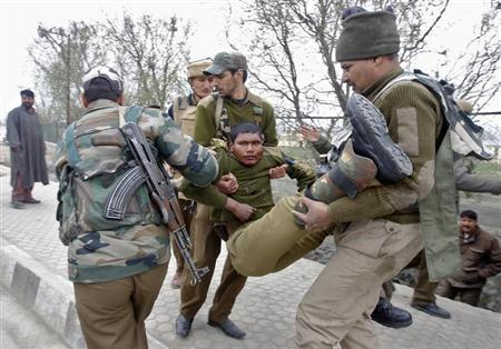 Indian paramilitary soldiers carry their injured colleague to a hospital during a gunfight in Srinagar March 13, 2013. Two militants wielding automatic rifle opened fire on a paramilitary camp on the Indian side of the disputed region of Kashmir on Wednesday, killing five Indian personnel and wounding five, police said. REUTERS/Danish Ismail