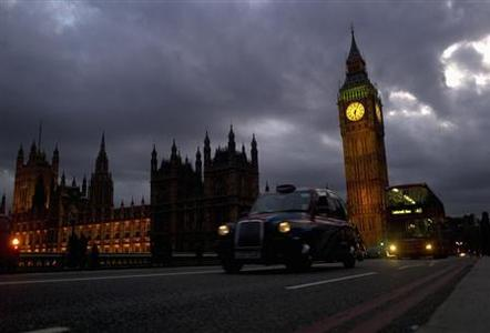 A bus and taxi pass Big Ben on Westminster Bridge in London March 10, 2012. REUTERS/Kieran Doherty